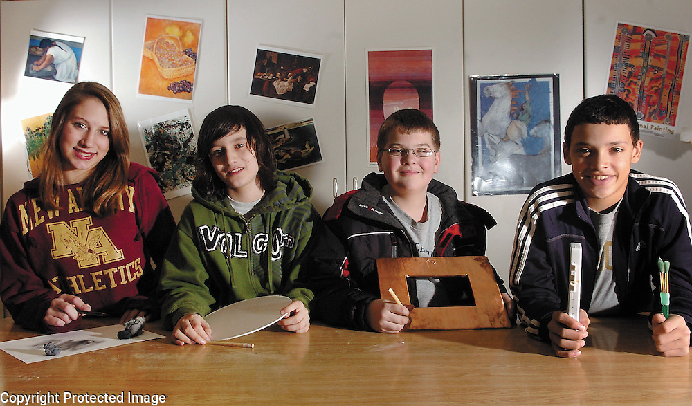 New Albany Middle School students (from left): Heather Bartholomew, Bert Villena, Evan Taylor and Jalen Rhea each will have artwork on display at Columbus College of Art and Design from Jan. 18-31.  The students' works were chosen to be a part of the 2008 Central Ohio Regional Scholastic Art Awards competition....New Albany Middle School students (from left): Heather Bartholomew, 8th, Bert Villenn, 8th, Evan Taylor, 7th, and Jalen Rhea, 7th each have artwork which will be on display at Columbus College of Art & Design from Jan. 18th -31st.