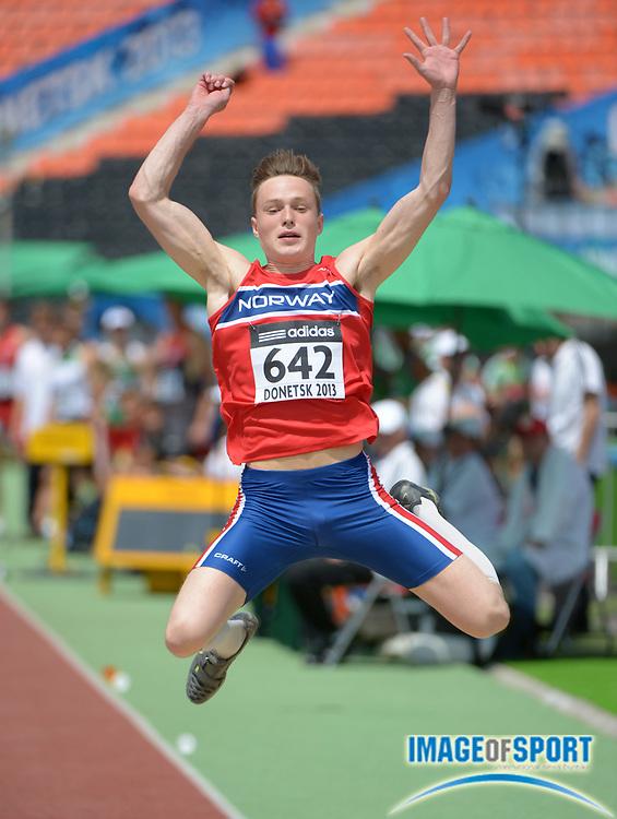 Jul 10, 2013; Donetsk, UKRAINE; Karsten Warholm (NOR) jumps 23-11 1/2 (7.30m) in the octathlon long jump in the 2013 IAAF World Youth Championships at Olimpiyskyi Stadium.