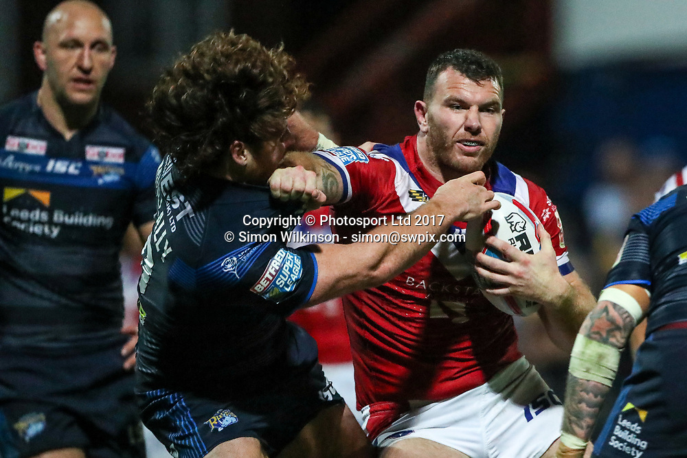 Picture by Alex Whitehead/SWpix.com - 10/08/2017 - Rugby League - Betfred Super League - Wakefield Trinity v Leeds Rhinos - Beaumont Legal Stadium, Wakefield, England - Wakefield's Keegan Hirst is tackled by Leeds' Anthony Mullally.