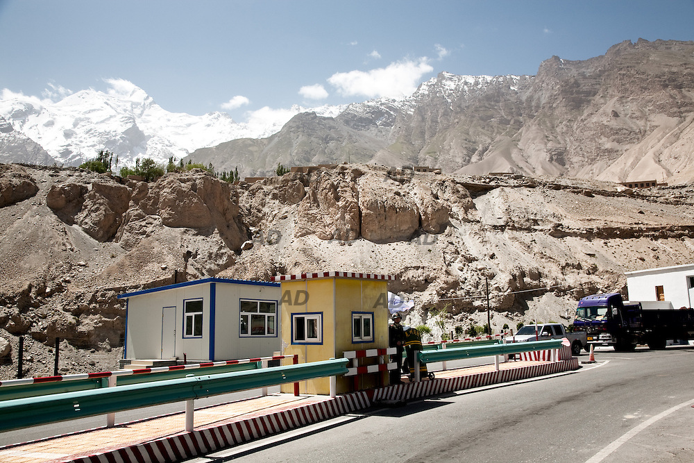 The Karakoram Highway (KKH) is the highest paved international road in the world. It connects China and Pakistan across the Karakoram mountain range, through the Khunjerab Pass, at an elevation of 4,693 metres.<br /> It connects China's Xinjiang region with Pakistan's Gilgit&ndash;Baltistan and Khyber regions.<br /> It was told me that there was a new route for Chinese goods. A new route that would allowed it to jump all over the South China Sea and arrive directly on the Arabian Sea, to the Gwadar port.<br /> It was a story that there was no, actually.<br /> Maybe one day there will be this route. But it did not exist when I did it, in 2009.<br /> Just few trucks climbed it and an Indian trader, who was traveling with me, told me that his goods would have paid much less traveling by sea from Shenzhen, rather than overland through Xinjiang and the KKH. And it would take even less time.<br /> It was a nice trip, however. In one of the most remote places on earth. You could hear the echo of the attacks of the Taliban, we had to wait a couple of hours to release the road to a car exploded on a bridge. At press office in Islamabad they told me that it was impossible to visit Gwadar. So I went to Karachi, where I made a reportage about the secular party MQM, then published &quot;Ventiquattro&quot;.