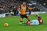 Hull City midfielder Ahmed Elmohamady tackeled by Burnley defender Ben Mee during the Sky Bet Championship match between Hull City and Burnley at the KC Stadium, Kingston upon Hull, England on 26 December 2015. Photo by Ian Lyall.