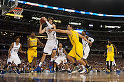 Jeff Withey (5) of the University of Kansas Jayhawks grabs a rebound against the University of Michigan Wolverines during the NCAA South Regionals at Cowboys Stadium in Arlington on Friday, March 29, 2013. (Cooper Neill/The Dallas Morning News)