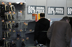© Licensed to London News Pictures. 18/12/2012.Comets last day trading.80% off as shoppers at the Comet store in Crayford,Kent look for a bargain..Today (18.12.2012) is the last day trading for electrical retailer Comet. After going into administration the last 50 stores close today.Photo credit : Grant Falvey/LNP