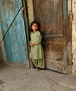 Afghan child in doorway.   (U.S. Air Force photo/Master Sgt. Lance Cheung)<br />