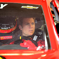 Driver Jamie McMurray is seen in his car during the 56th Annual NASCAR Daytona 500 practice session at Daytona International Speedway on Saturday, February 22, 2014 in Daytona Beach, Florida.  (AP Photo/Alex Menendez)