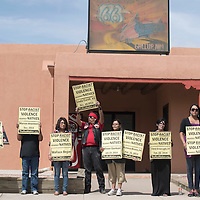 040415      Cayla Nimmo<br /> <br /> A group of protestors lead by the indigenous rights group, The Red Nation, hold anti-racism signs in front of the Gallup Chamber of Commerce along Route 66 Saturday. Each sign used in the protest held the name of a native person who died of unnatural causes in Gallup and surrounding areas since funding was cut to NCI.