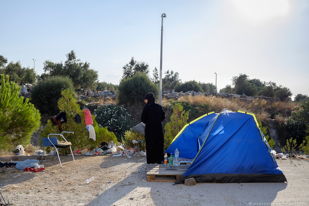 Lady next to her tent, outside refugee camp Kara Tepe near Mytilene city. It hosts Syrian refugees who are waiting for their registration papers that will allow them to stay in Greece for some time till they can move to an other European country.