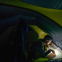 Seattle backpacker Andrew Zellis studies the route out of Olympic National Park's Enchanted Valley on Sept. 14, 2018, the final night of a soggy four-day backpacking trip.