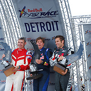 Kirby Chambliss, Hannes Arch and Paul Bonhomme on the award stand, with their trophy's, at the Red Bull Air Race in Detroit, MI.
