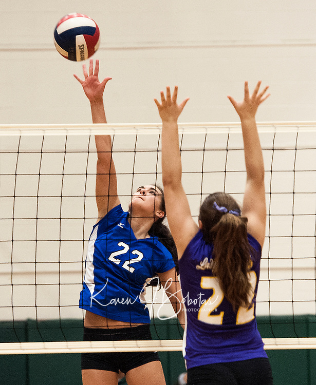 Interlake's Jessica Schofield goes up for a block against Nute's Nichole Flanagan during NHIAA Division III Semi Final Volleyball at Plymouth State University Wednesday evening.  (Karen Bobotas/for the Laconia Daily Sun)