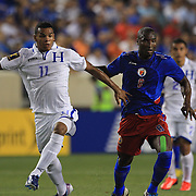 Rony Martínez, Honduras, (left) and Aveska Judelin, Haiti, challenge for the ball during the Haiti V Honduras CONCACAF Gold Cup group B football match at Red Bull Arena, Harrison, New Jersey. USA. 8th July 2013. Photo Tim Clayton