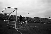 21/04/1963<br /> 04/21/1963<br /> 21 April 1963 <br /> Soccer: Cork Hibernians v Shelbourne, F.A.I. Cup Semi-final at Dalymount Park, Dublin. John Heavey, Shels goalie punches clear from the advancing Tommy Hamilton  of Cork Hibs.