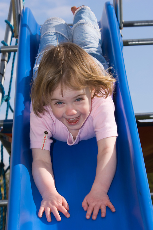 Girl, 3, going down a slide