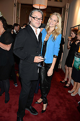 DAVID DOWNTON and POPPY DELEVINGNE at a private view of fashion art by David Downton as in-house artist at Caridge's , held at Claridge's Hotel, London on 13th September 2013.