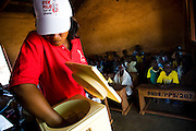 A health worker prepares to vaccinate children during a national polio immunization exercise at the Moglaa primary school in the town of Moglaa, northern Ghana on Friday March 27, 2009.