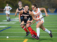 AMBLER, PA -  NOVEMBER 9: Archbishop Carroll's Courtney Brady (6) chases after Gwynedd Mercy's Nicole Catalino (18) in the first half of a playoff field hockey game between Archbishop Carroll and Gwynedd Mercy Academy at Wissahickon High School November 9, 2013 in Ambler Pennsylvania. (Photo by William Thomas Cain/Cain Images)