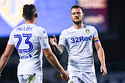 Liam Cooper of Leeds United (6) shakes hands with Kalvin Phillips of Leeds United (23) after the EFL Sky Bet Championship match between Leeds United and Bristol City at Elland Road, Leeds, England on 24 November 2018.