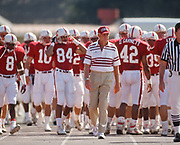 PALO ALTO, CA -  SEPTEMBER 26:  Head coach Bill Walsh of Stanford University leads the team onto the field before an NCAA football game against San Jose State played at Stanford Stadium in Palo Alto, California on September 26, 1992.