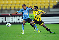 Sydney FC's Fabio, left contests the ball with Wellington Phoenix's Benjamin Totori in the A-League football match at Westpac Stadium, Wellington, New Zealand, Saturday, October 06, 2012. Credit:SNPA / Ross Setford