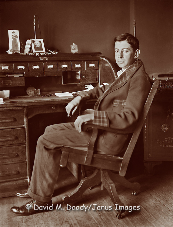 Vintage Image:  Man in his office with roll top desk and safe, circa 1900