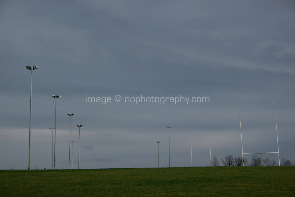 Football goal posts with dramatic grey clouds just before the rain at a park in Dublin Ireland