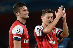 LONDON, ENGLAND - Oct 01: Arsenal's forward Olivier Giroud from France and Arsenal's midfielder Mesut Ozil from Germany during the UEFA Champions League match between Arsenal from England and Napoli from Italy played at The Emirates Stadium, on October 01, 2013 in London, England. (Photo by Mitchell Gunn/ESPA)