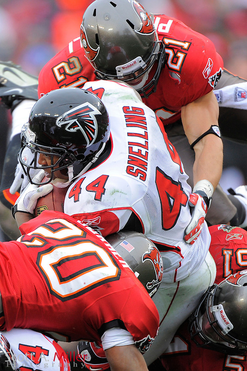 Jan. 3, 2010; Tampa, FL, USA; Atlanta Falcons running back Jason Snelling (44) is tackled by Tampa Bay Buccaneers safety Sabby Piscitelli (21), linebacker Barrett Ruud (51) and cornerback Ronde Barber (20) during the Falcons 20-10 win at Raymond James Stadium. ©2009 Scott A. Miller