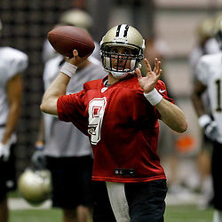 July 26, 2012; Metairie, LA, USA; New Orleans Saints quarterback Drew Brees (9) works on a passing drill during the first day of of training camp at the team's indoor practice facility. Mandatory Credit: Derick E. Hingle-US PRESSWIRE