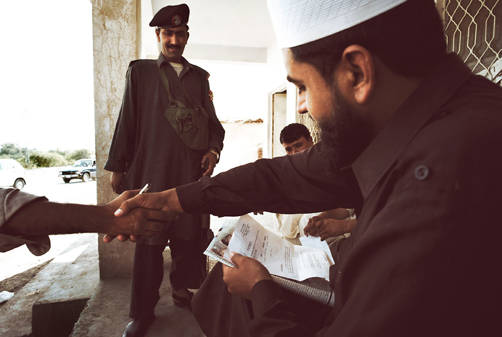 A checkpoint entering the Khyber region where driver and passenger documents are checked and signed at the Smuggler's Bazaar, Khyber-Pakhtunkhwa, Pakistan on 25th Sep, 2007...