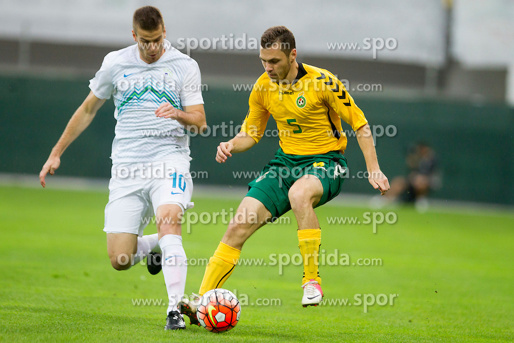 Domen Crnigoj #10 of Slovenia and Lukas Cerkauskas #5 of Lithuania during football match between U21 National Teams of Slovenia and Lithuania in 2nd Round of UEFA 2017 European Under-21 Championship Qualification on September 4, 2015 in Arena Petrol, Celje, Slovenia. Photo by Urban Urbanc / Sportida