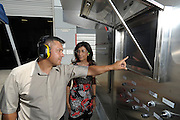 Jorge Villegas and Kusum Kavia look at a control panel on the Spirit 1 MW Turbine Power Generation System at Combustion Associates, Inc. in Corona, CA 8/17/2015 (photo by John McCoy)
