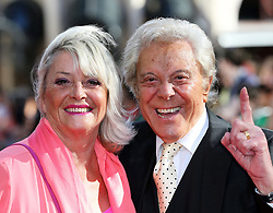 Image ©Licensed to i-Images Picture Agency. 10/06/2014 London, United Kingdom.Lionel Blair and wife arriving at the 50th anniversary screening of Zulu in London.  Picture by Stephen Lock / i-Image