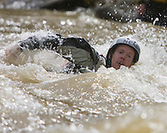 photo Randy Vanderveen, .Grande Prairie, Alberta.Grande Prairie firefighter Neal Young swims across the Red Willow River during a swift water training class.