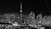 Panoramic of Toronto Bay at Night. Boats and CN Tower in the scene.