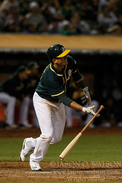 OAKLAND, CA - JULY 19:  Ryon Healy #48 of the Oakland Athletics hits a two-run double against the Houston Astros during the seventh inning at the Oakland Coliseum on July 19, 2016 in Oakland, California. The Oakland Athletics defeated the Houston Astros 4-3 in 10 innings.  (Photo by Jason O. Watson/Getty Images) *** Local Caption *** Ryon Healy