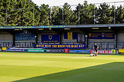 Groundsman preparing for kick off during the EFL Cup match between AFC Wimbledon and Milton Keynes Dons at the Cherry Red Records Stadium, Kingston, England on 13 August 2019.