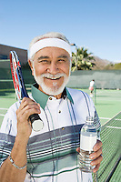 Senior man at tennis court, portrait