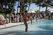 O DANCE COMPANY PERFORMANCE IN POOL, Sagamore Hotel Art Basel brunch.   Miami Beach. 4 December 2010. -DO NOT ARCHIVE-© Copyright Photograph by Dafydd Jones. 248 Clapham Rd. London SW9 0PZ. Tel 0207 820 0771. www.dafjones.com.