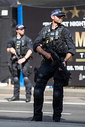 © Licensed to London News Pictures. 03/06/2018. London, UK. Armed police on London Bridge as a service takes place on the anniversary of the London Bridge and Borough Market terror attacks. A series of events have taken place throughout the day, including a service of commemoration at Southwark Cathedral, the planting of an olive tree in the Cathedral grounds, a minute's silence at 4:30pm and the laying of flowers.  Photo credit : Tom Nicholson/LNP