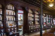 Old medicine bottles pharmacy display in Farmacia Dr A Alonso Nunez pharmacy shop in Calle Ancha, Leon, Castilla y Leon, Spain