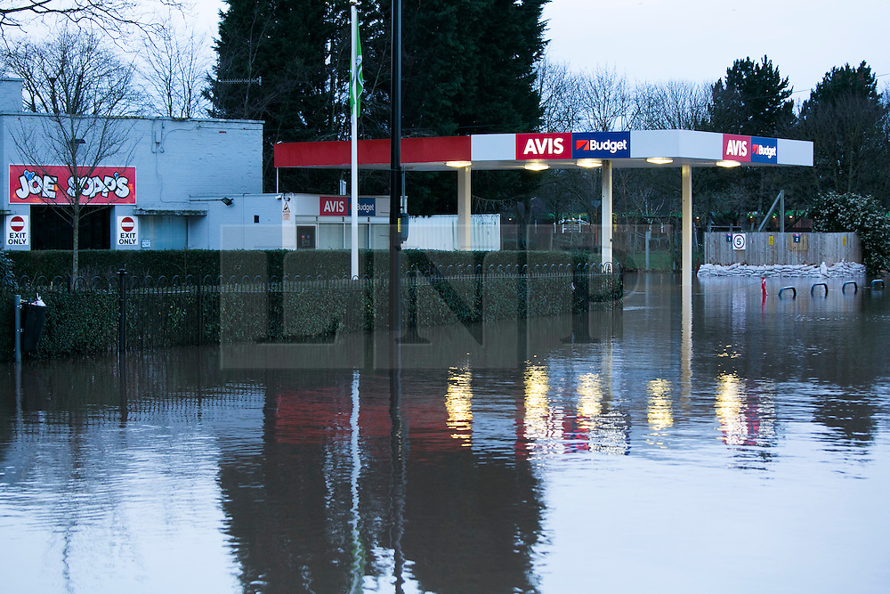 "© Licensed to London News Pictures. 13/2/2014. Worcester, UK. The River Severn flowing through Worcester reaches an all time high. Pictured, ""Joe Soaps"" car wash under water. Photo credit : Dave Warren/LNP"