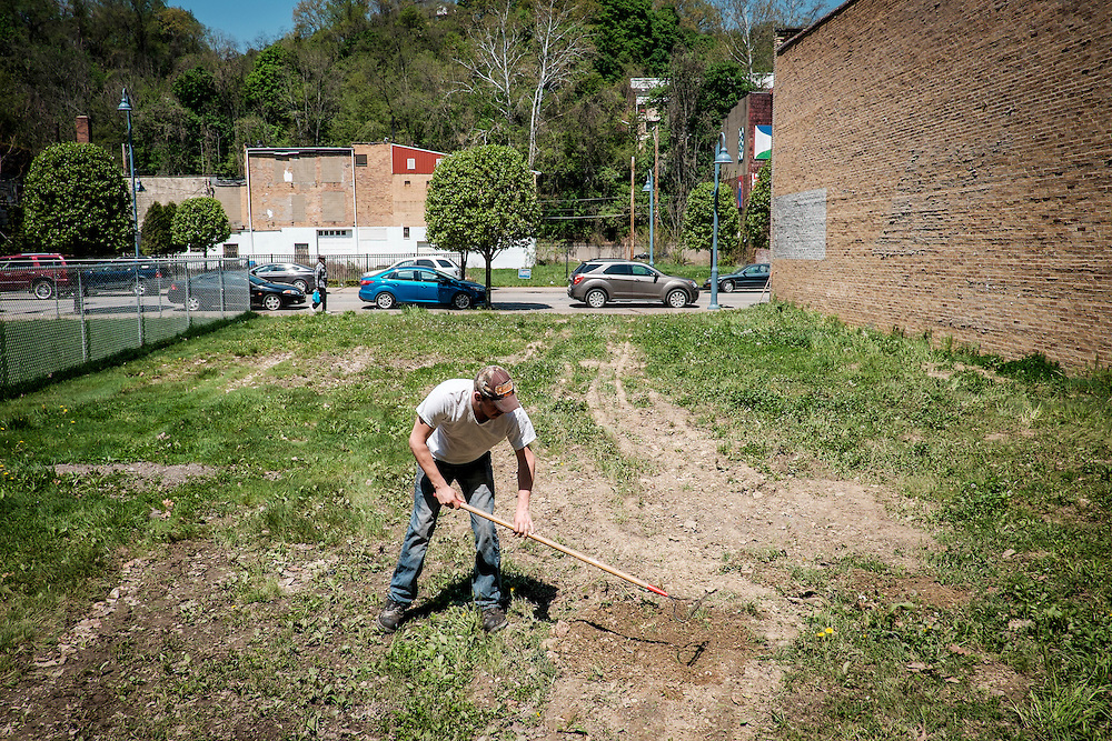 Charles Calderrone, 29, cleans up a rocky lot next to to his boss's business in Aliquippa, Pa.<br /> Calderonne says he needs to get all the exercise he can since he is joining the Army in a few months to get his life together and have some kind of future.