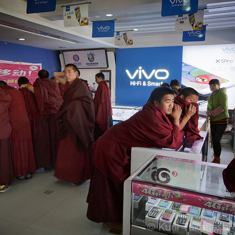 Buddhist monks hang out at mobile phone shop in Lnagmusi, Gansu Province in Tibetan part of China on Oct 13, 2015.<br /> (Photo by Kuni Takahashi)