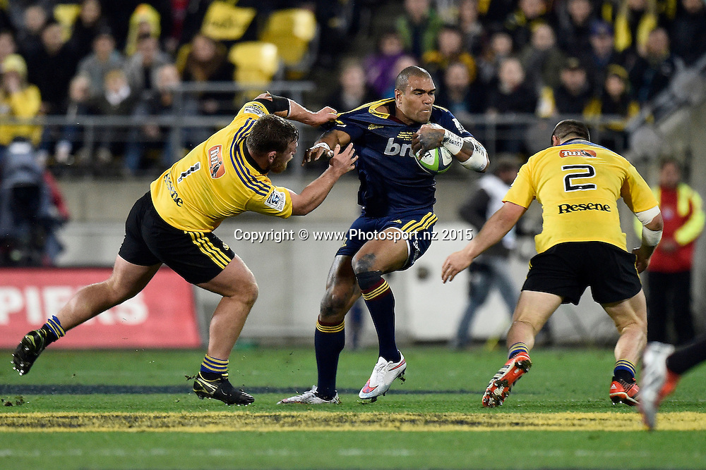 Patrick Osborne (C of the Highlanders is tackled by Reggie Goodes (L) and Dane Coles of the Hurricanes during the Super Rugby final rugby match between the Hurricanes and Highlanders at the Westpac Stadium in Wellington on Saturday the 4th of July 2015. Copyright photo by Marty Melville / www.Photosport.nz