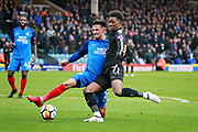 Peterborough United defender Ryan Tafazolli (5) tackles Leicester City midfielder Demarai Gray (7) on the edge of the box during the The 4th round FA Cup match between Peterborough United and Leicester City at London Road, Peterborough, England on 27 January 2018. Photo by Nigel Cole.