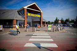 Morrisons supermarket entrance and pedestrian crossing, Gamston, Nottinghamshire, England, UK.