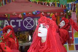 Extinction Rebellion Cambridge Red Brigade protest at Latitude music festival, UK July 2019.