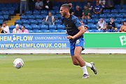 AFC Wimbledon defender Nesta Guinness-Walker (18) warming up during the EFL Sky Bet League 1 match between AFC Wimbledon and Rotherham United at the Cherry Red Records Stadium, Kingston, England on 3 August 2019.