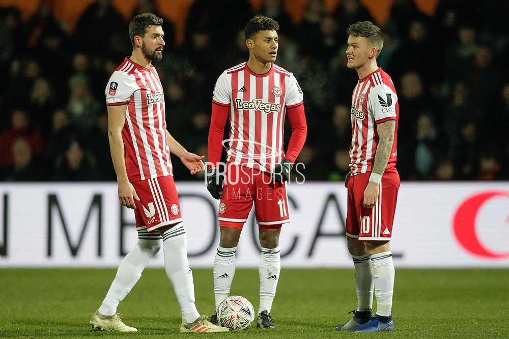 Brentford defender Yoann Barbet (29) Brentford forward Ollie Watkins (11) and Brentford midfielder Josh McEachran (10) during The FA Cup fourth round match between Barnet and Brentford at The Hive Stadium, London, England on 28 January 2019.