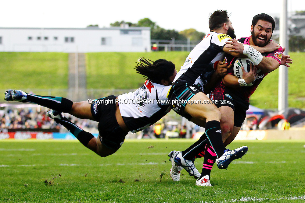 Konrad Hurrell of the Warriors breaks the tackles on his way to score a try. Round 16 NRL Telstra Premiership game, Vodafone Warriors v Penrith Panthers, Mt Smart Stadium, Auckland, New Zealand. Sunday 29th June 2014. Photo: photosport.co.nz
